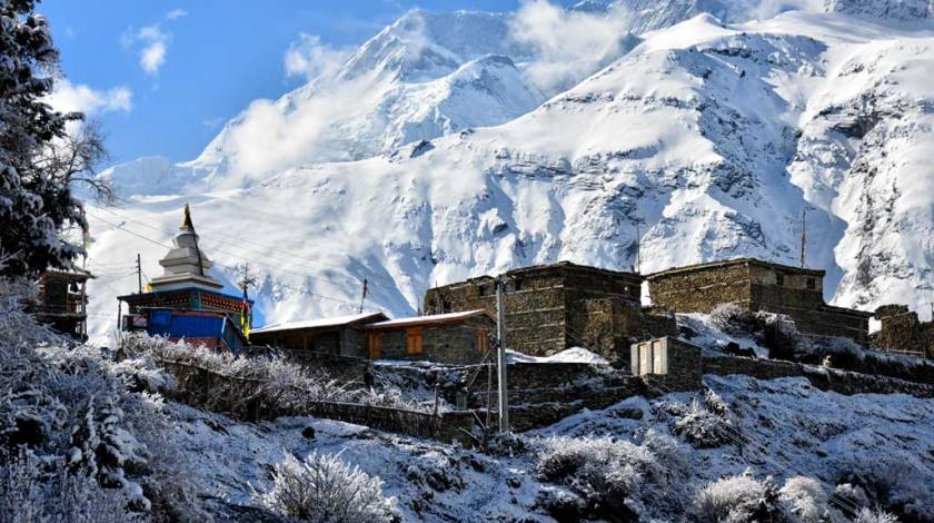 Stone houses on the lap of snow capped peaks