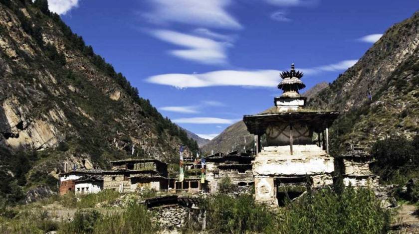 Passing through Buddhist chortens and stone-mud house villages